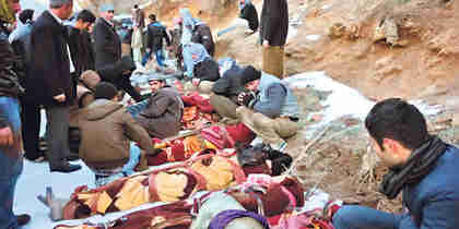 The families of the 36 smugglers killed in the Turkey's airstrikes retrieve the bodies