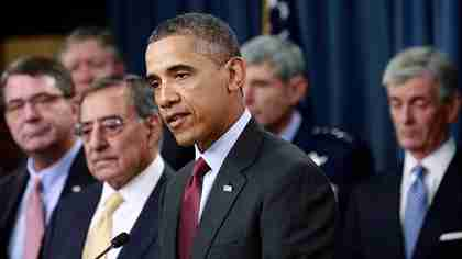 Defense Secretary Leon Panetta to the right of a gaunt President Obama announcing defense budget cuts on Thursday (AP)