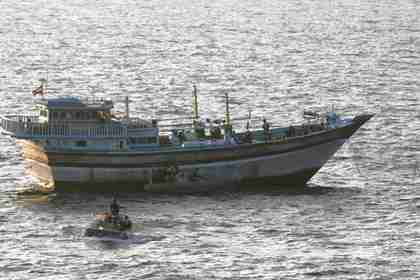 U.S. boarding team operates on the deck of the Iranian-flagged fishing dhow