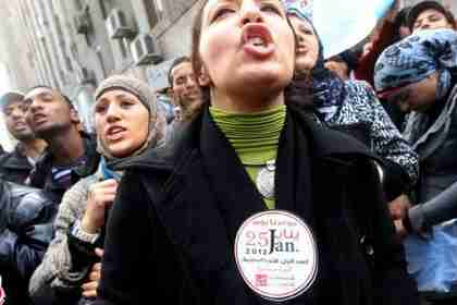 Egyptian women chant slogans against the ruling military council and the government (AFP)