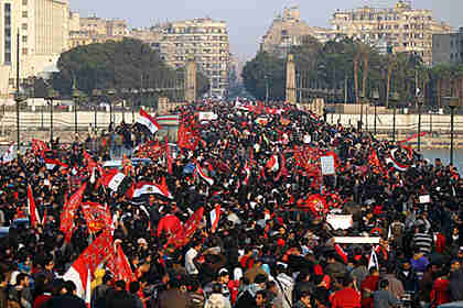 Thousands of Egyptians march in a protest from the Al-Ahly club to the headquarters of the ministry of interior in Cairo. (AFP)