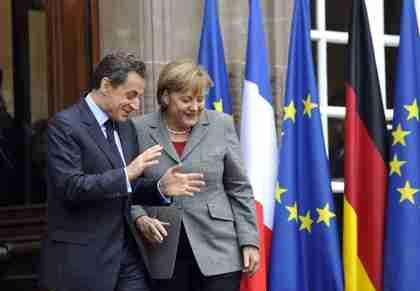 Nicolas Sarkozy and Angela Merkel (AFP)