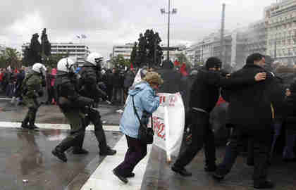 Police try to disperse anti-austerity protesters in Athens on Tuesday (Reuters)
