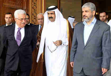 L-to-R: Fatah chief Mahmoud Abbas, Qatar's Emir Sheikh Hamad bin Khalifa al-Thani and Hamas leader Khaled Meshaal on February 6 in Doha (Reuters)