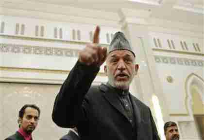 Afghan president Hamid Karzai at news conference on Sunday (Reuters)
