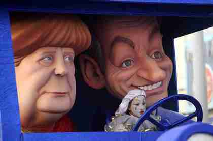 Float mocking Merkel's open support of Sarkozy appearing in a German carnival celebration last month (DPA)