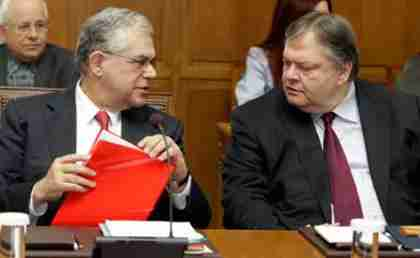 Prime Minister Lucas Papademos (left) speaks to Finance Minister Evangelos Venizelos in Parliament on Friday. (Kathimerini)