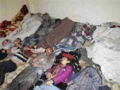 Bodies of people whom al-Assad's army massacred in Homs (Reuters)