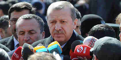 Erdogan at press conference after leaving a mosque on Friday (Zaman)