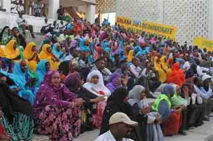 From March 19: Somalis in festive colors attend a concert in the newly opened Somali National Theatre.  A suicide bomber attack took place on April 4. (AP)