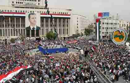Large pro-Assad rally in Damascus on Saturday (AP)