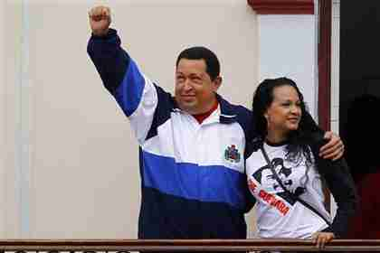 Hugo Ch�vez with his daughter, Virginia, waving from the People's Balcony at Miraflores Palace in Caracas on Friday (Reuters)