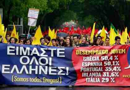 Young protesters in Lisbon carry a banner saying 'We are all Greek,' listing some youth unemployment rates.  (AP)