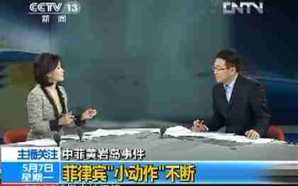He Jia (left) says that China has 'unquestionable sovereignty' over the Philippines (CCTV)