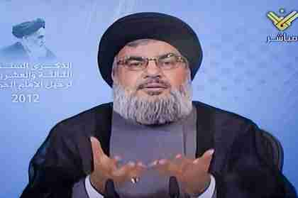 Sayyed Hasan Nasrallah on television Friday.  Iran's Supreme Leader is in the upper left corner. (The Daily Star, Lebanon)