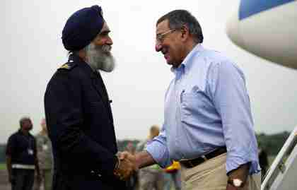 Leon Panetta and Singapore Colonel Sarbjit Singh (Reuters)