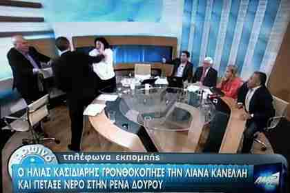 Ilias Kasidiaris slaps Liana Kanelli (in white) on nationwide Greek TV