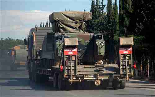 A Turkish military truck transports a mobile missile launcher to the Syrian border (AP)