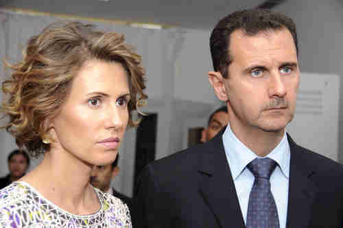 Bashar al-Assad, who wears a Hitler-like mustache, and his lovely wife Asma.  Supposedly, the e-mail messages contain personal information about their relationship. (AP)