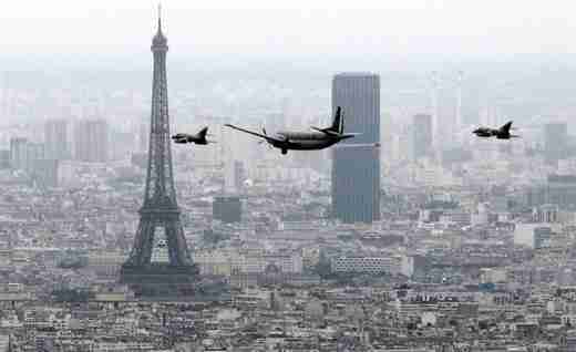 French fighters and reconnaissance aircraft fly over Paris during the Bastille Day military parade in Paris on July 14 (AFP)