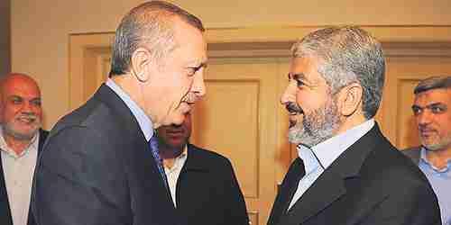 Recep Tayyip Erdogan shakes hands with Khaled Mashaal (EPA)