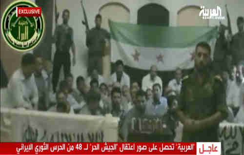 Syrian rebels holding kidnapped Iranians in Damascus, shown in screen grab (Al-Arabiya)