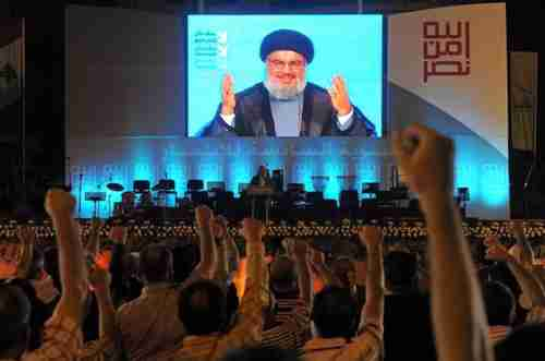 Hizbollah Secretary-General Hassan Nasrallah speaks to enthusiastic supporters (EPA)
