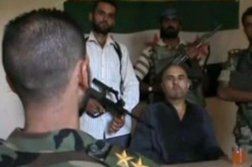 Syrian rebels with captured pilot -- still image from video (al-Jazeera)