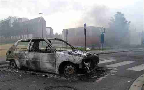 Burnt out car in Amiens (AP)
