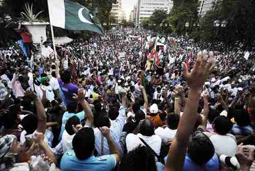 Thousands of mostly Pakistani immigrants protest in Athens on Friday (AFP)
