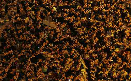Hong Kong - Tens of thousands of protesters cross their arms, symbolically saying 'Stop' to the government. (AP)