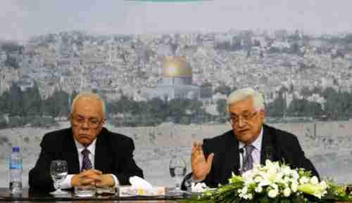 PA President Mahmoud Abbas (R) at press conference in Ramallah on Saturday (AP)