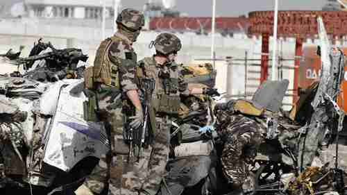 French soldiers arrive at the scene of Tuesday suicide bombing in Kabul (AP)