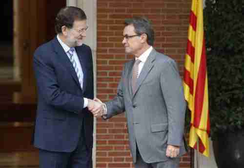 Spain's Prime Minister Mariano Rajoy (L) shakes hands with Catalonia's President Artur Mas, prior to their meeting on Thursday.  Reports indicate that the meeting didn't go well.  (Reuters)