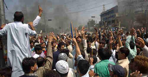 Protesters in Rawalpindi, near Islamabad (AP)