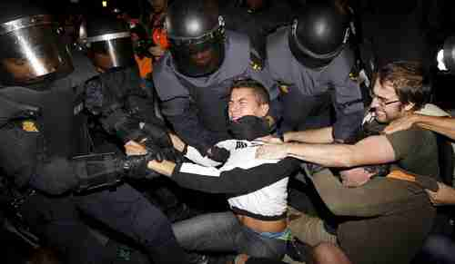 Riot police struggle with protesters during demonstrations in Madrid against austerity cutbacks. (EPA)