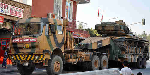Turkey deploys armored vehicles to Syrian border on Friday, after Syrian mortars land in Turkey (AA)