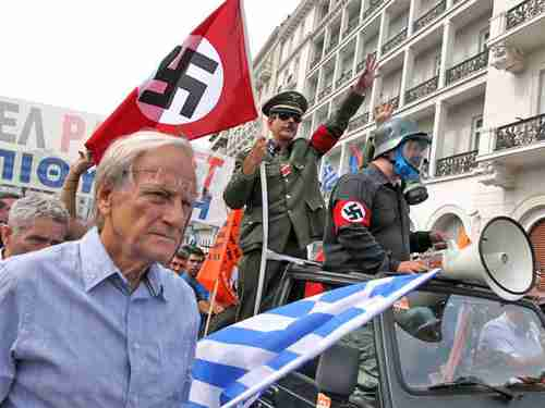 Angela Merkel greeted with Nazi salutes and violence in Athens (Getty)