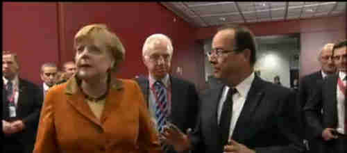 Bad body language between Angela Merkel and François Hollande (Al-Jazeera)