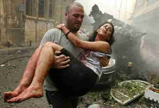 A woman is rescued from the Beirut bombing on Friday (Reuters)