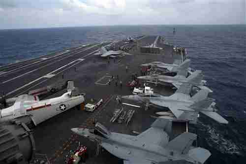 USS George Washington nuclear powered aircraft carrier in South China Sea on Saturday (AP)