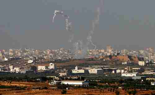Trails of smoke are seen after the launch of rockets from the northern Gaza strip towards Israel on Sunday. (Reuters)