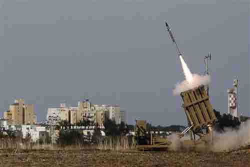 Israel launches a rocket from its 'Iron Dome' defensive system to intercept an incoming missile launched form Gaza.  (Reuters)