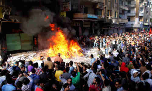 Protesters burn ransacked contents of Muslim Brotherhood offices in Alexandria