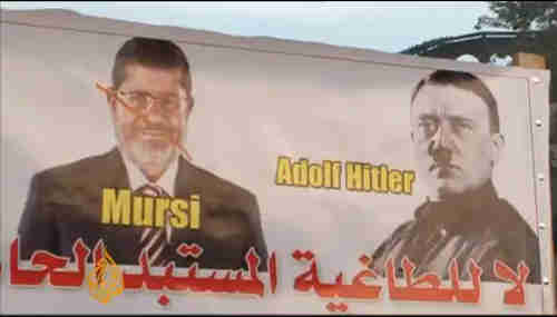 Anti-Morsi banner in Tahrir Square on Friday (al-Jazeera)
