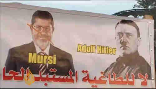 Anti-Morsi banner in Tahrir Square on Friday (al-Jazeera)