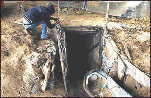 An Arab working outside a smuggling tunnel connecting Gaza with Egypt