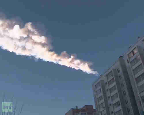 The trail of a meteorite is seen above a residential apartment block (Reuters)