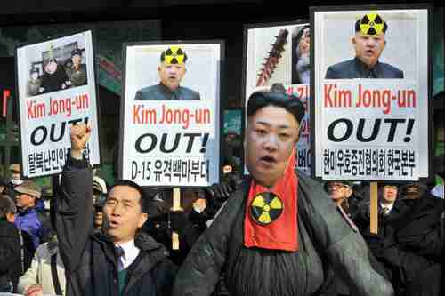S. Korean activists demonstrate behind an effigy of Kim Jong-un in Seoul on Feb 13