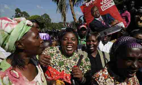 Kenyatta supporters celebrate victory on Saturday (AFP)